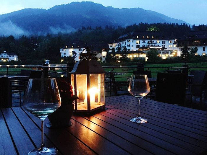 Night Illuminated Alcohol Table Wine Drink Mountain Outdoor Chair Water No People Travel Destinations Landscape Wineglass Outdoors Sky Nightlife Scenics Tree Wine Not