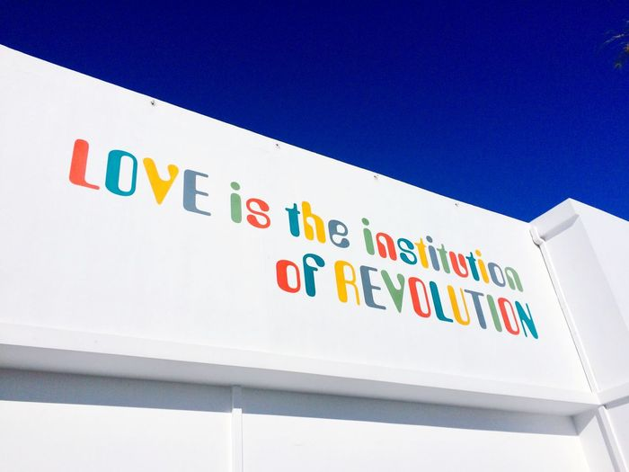 The writing's on the wall Writing On The Wall Revolution Love Message Blue Sky Text No People Low Angle View Communication Day Outdoors Close-up