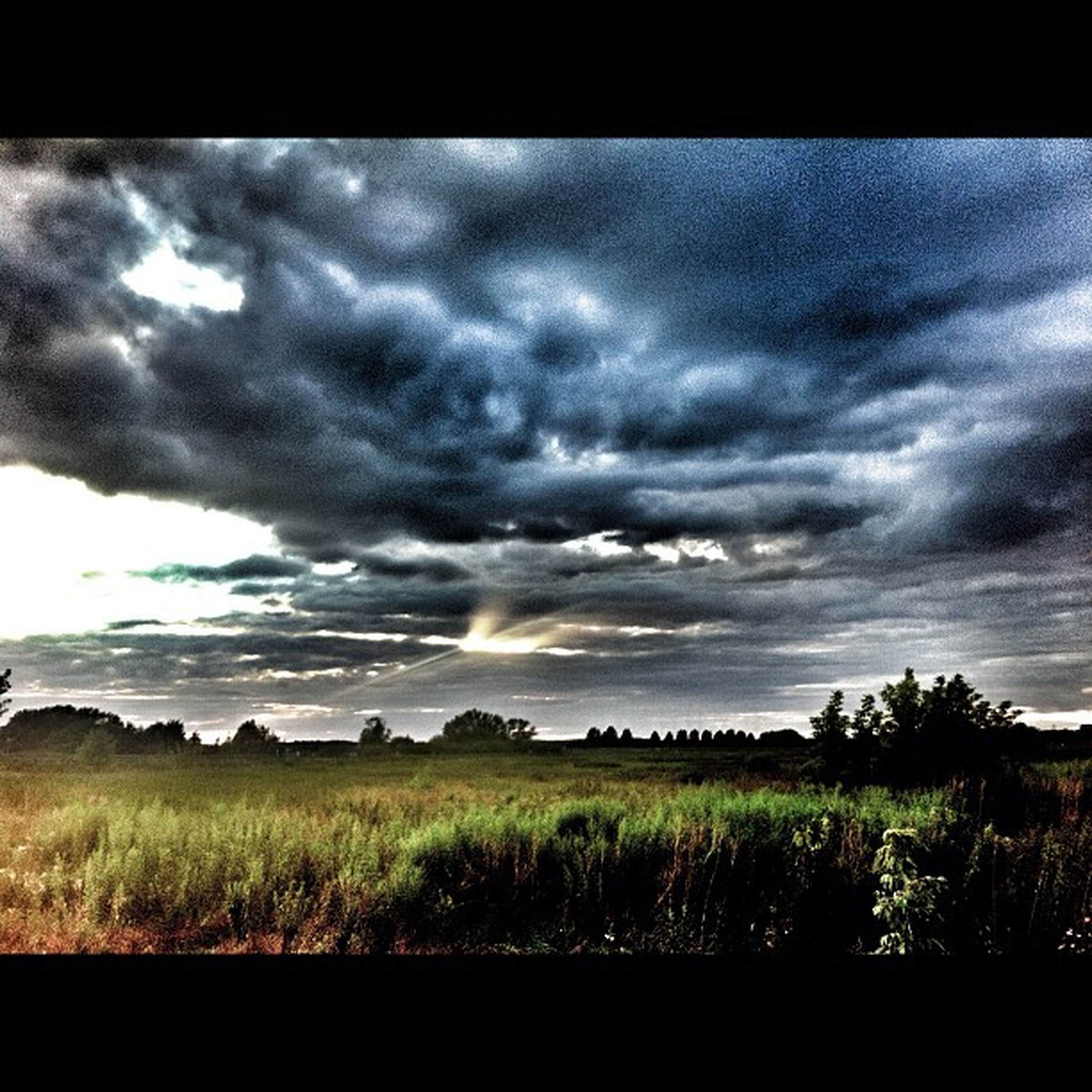 sky, cloud - sky, tranquil scene, cloudy, scenics, tranquility, landscape, transfer print, field, beauty in nature, sunset, grass, nature, cloud, auto post production filter, dramatic sky, overcast, weather, idyllic, sun