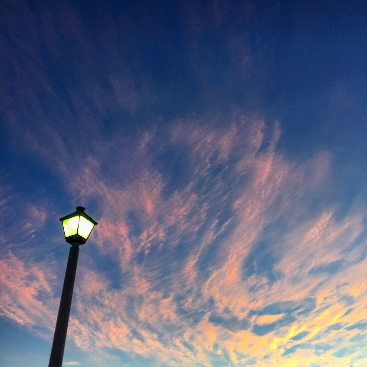 street light, lighting equipment, low angle view, illuminated, sky, cloud - sky, floodlight, outdoors, no people, nature, day