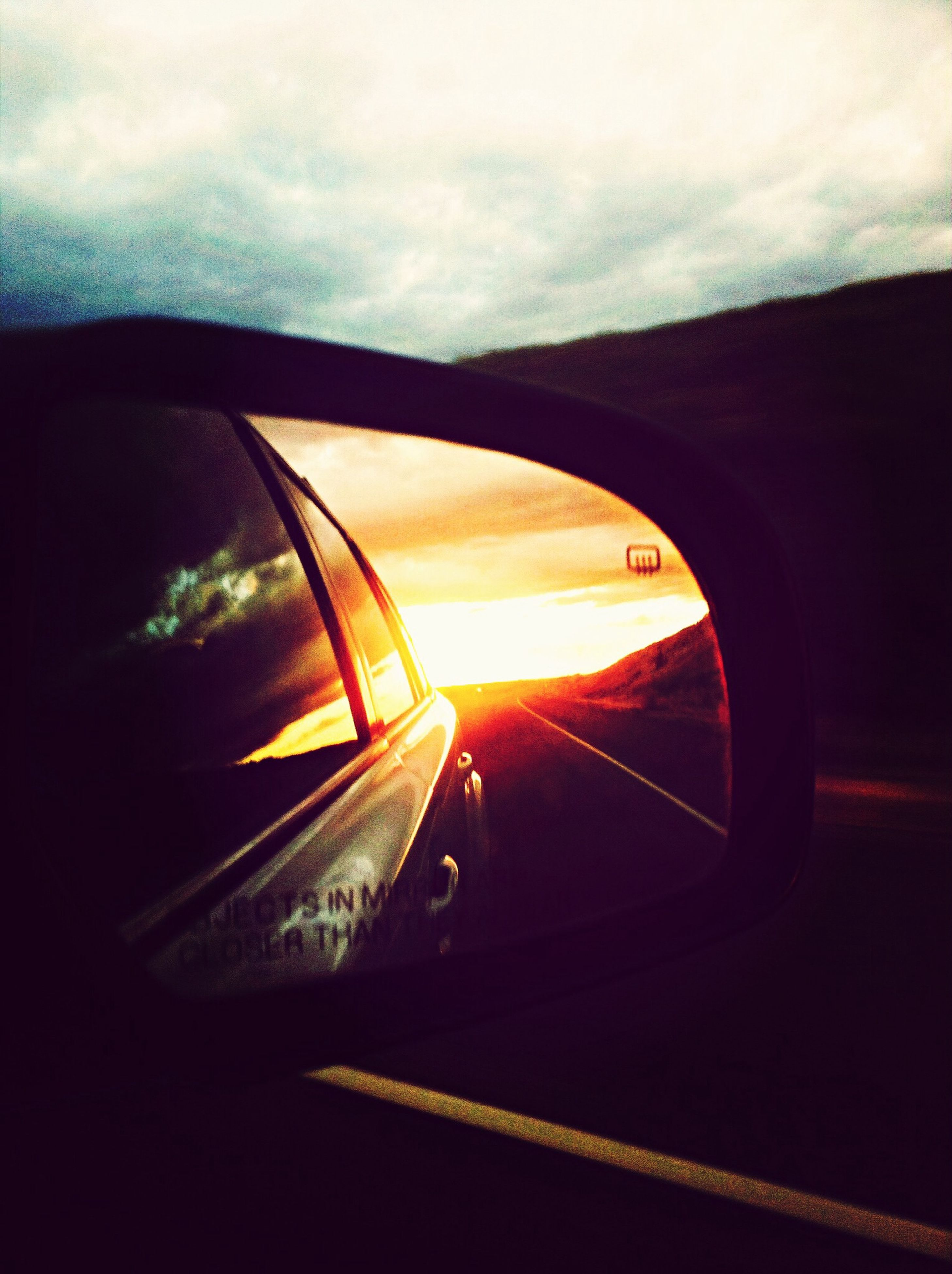transportation, mode of transport, land vehicle, car, sunset, sky, part of, cropped, cloud - sky, reflection, sun, travel, road, vehicle interior, side-view mirror, sunlight, glass - material, car interior, orange color, no people