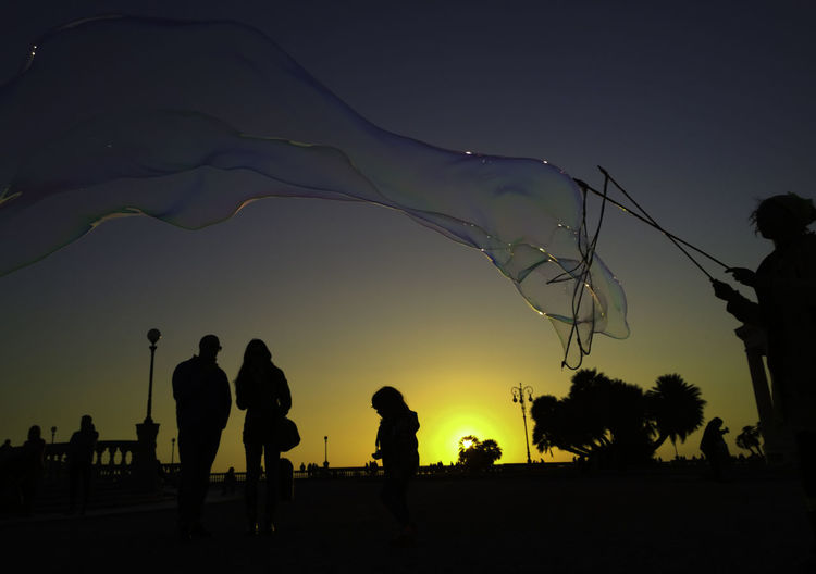 soap bubble maker at terrazza Mascagni Livorno Italy at easter time Bubbles Clear Sky Copy Space Dusk Enjoyment Group Of People Italy Italy❤️ Large Group Of People Leisure Activity Lifestyles Livorno Medium Group Of People Men Nature Outline Person Silhouette Sky Soap Bubbles Standing Sunset Terazza Mascagni Togetherness Tree the following Place Of Heart