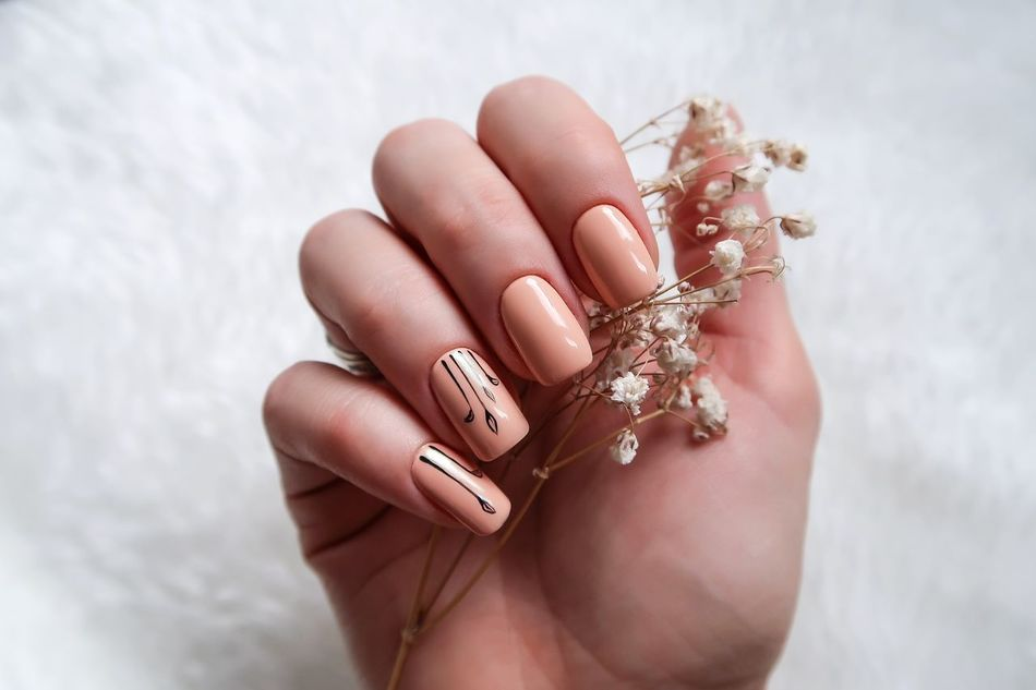 Creative manicure beige color Arm Art Beige Beige Tones Close-up Creative Fashion Hand Manicure Nail Art Nail Design Nail Polish Nails Natural Shellac Spring Flowers Stylish White Background