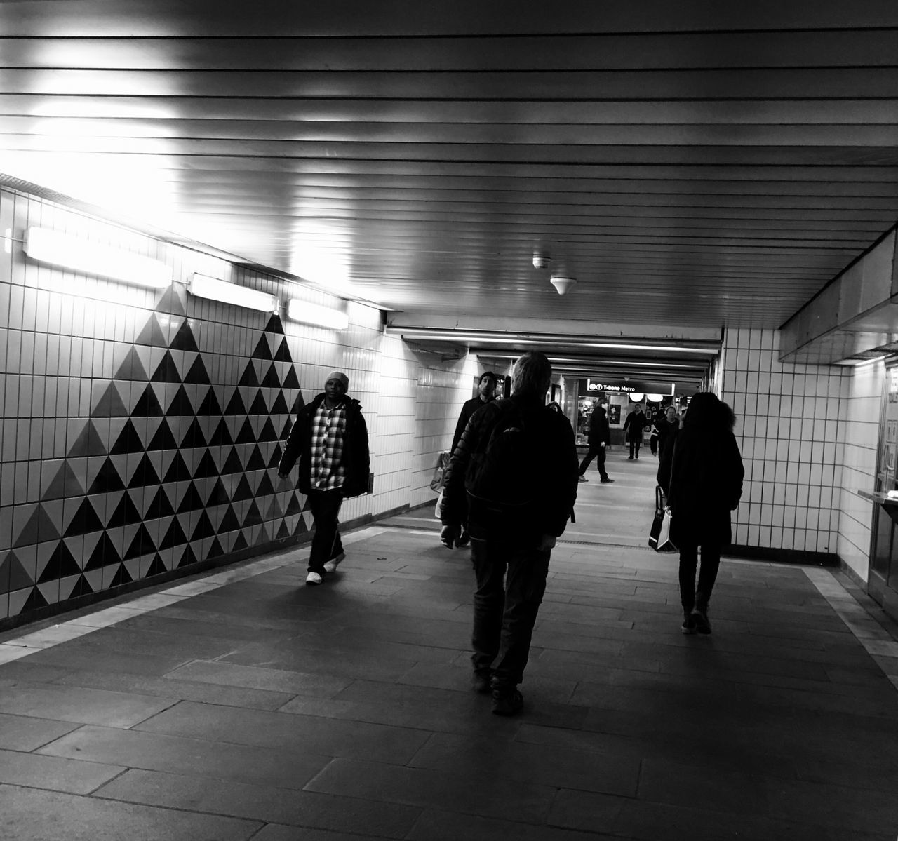 'Going Underground' Real People Men Indoors  Subway Station Illuminated Full Length Rear View Tiled Wall Tunnel People Adult Day Urbexphotography URBex Oslo Quickshots B&W Urbex Winter2016 ❄ Oslo, Norway Winter Has Come KariJosefiné✨