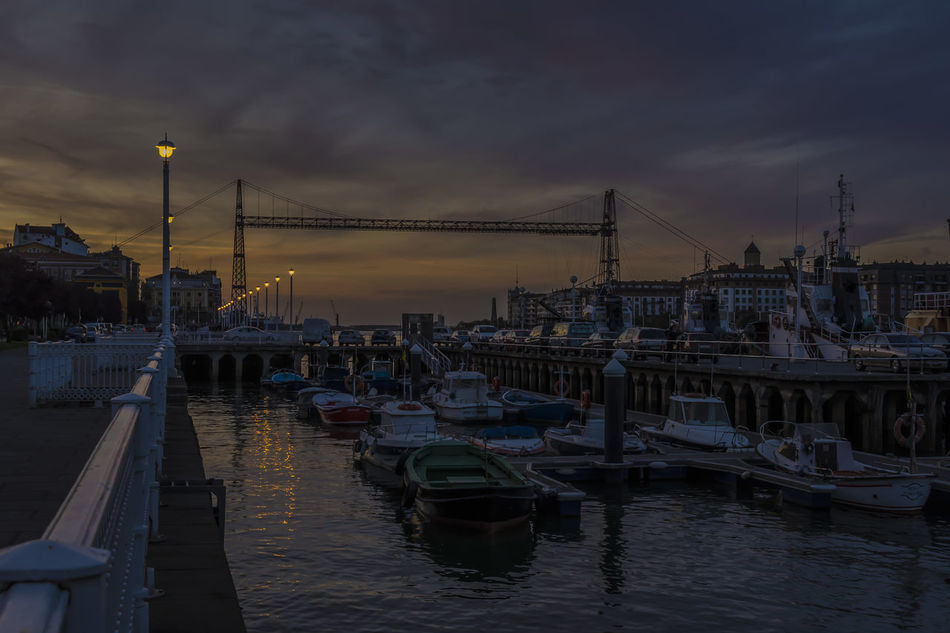 Water Reflection Bridge - Man Made Structure Sunset River Travel Destinations Sky Cityscape Architecture Nautical Vessel Harbor Tranquility Bilbaolovers Built Structure Cityscape Reflection
