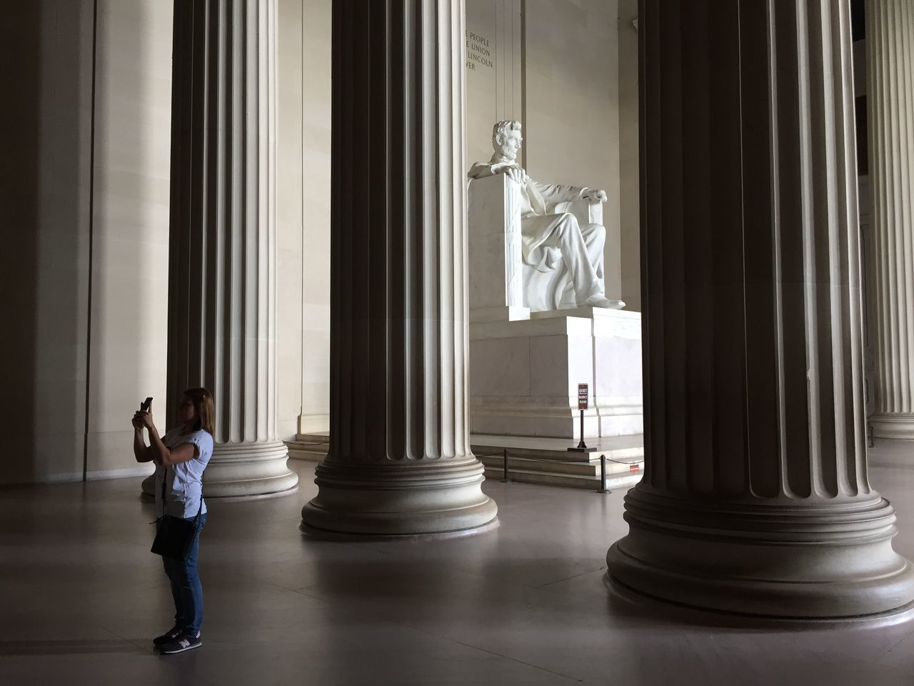 Statue Real People Human Representation Architectural Column Sculpture Casual Clothing Patriotism Flag Full Length Day Indoors  Women Architecture One Person