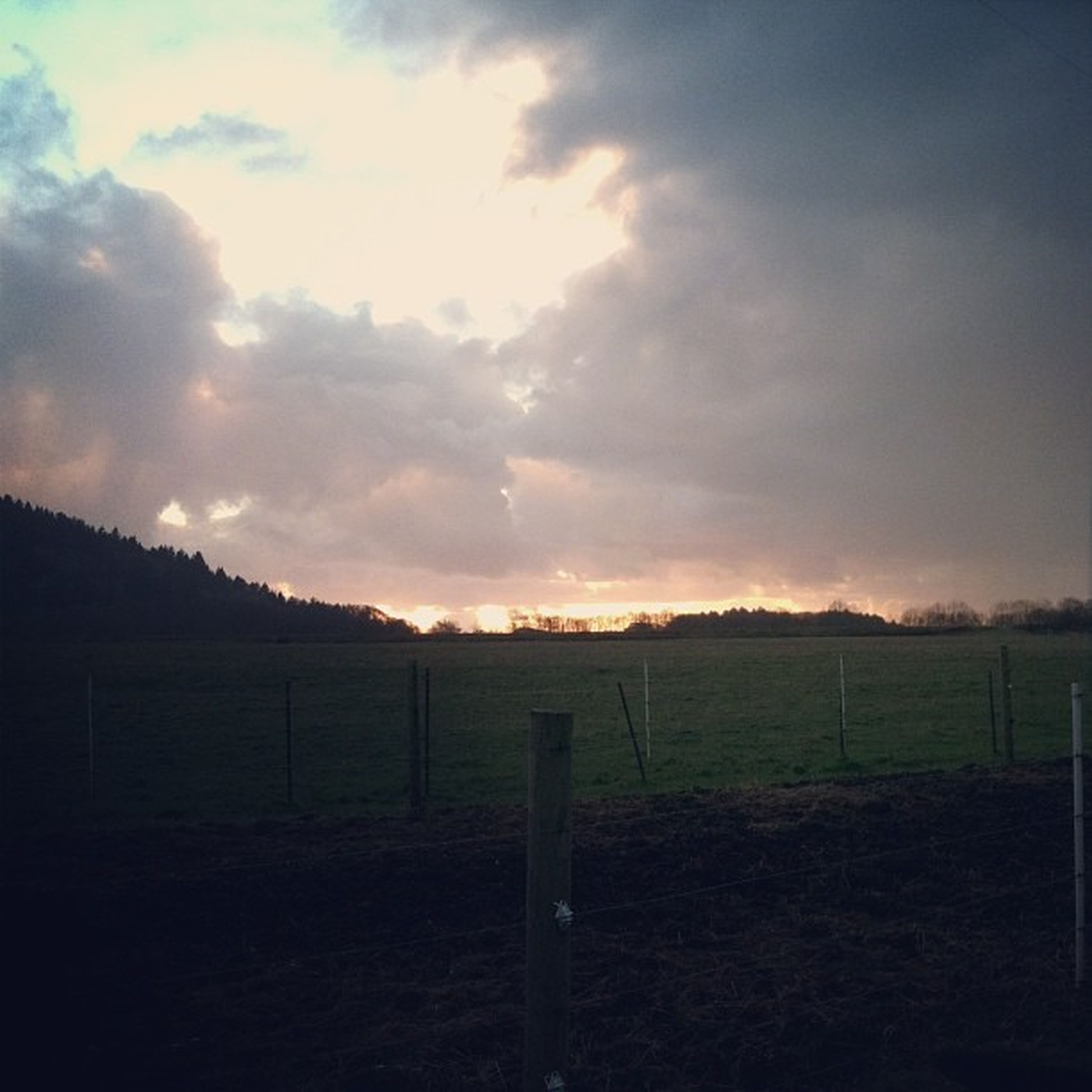 fence, sky, field, landscape, tranquility, tranquil scene, cloud - sky, grass, protection, scenics, nature, safety, beauty in nature, rural scene, sunset, grassy, railing, cloud, security, cloudy