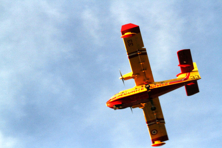 Blue Bomber Canadair Canadair Jet 200 Cloud Cloud Cloud - Sky Clouds And Sky Cloudy Day Firework France Photos Low Angle View No People Outdoors Plane Sky Sky And Clouds Water Bomber Yellow
