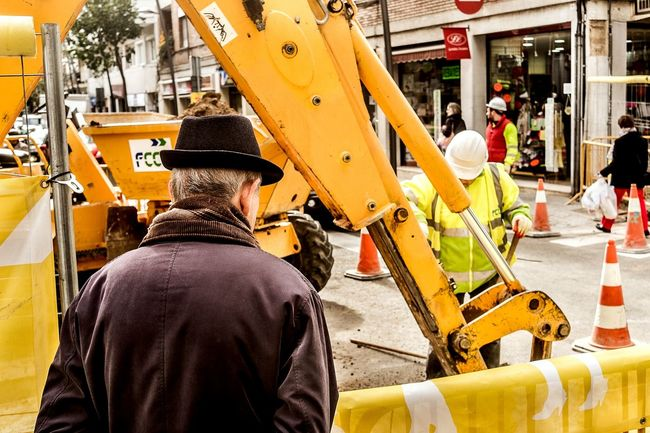 A classic: retired man passing time while watching the street works Open Edit Color Streetphotography People Street Streetphoto_color Hat Urban Scenes