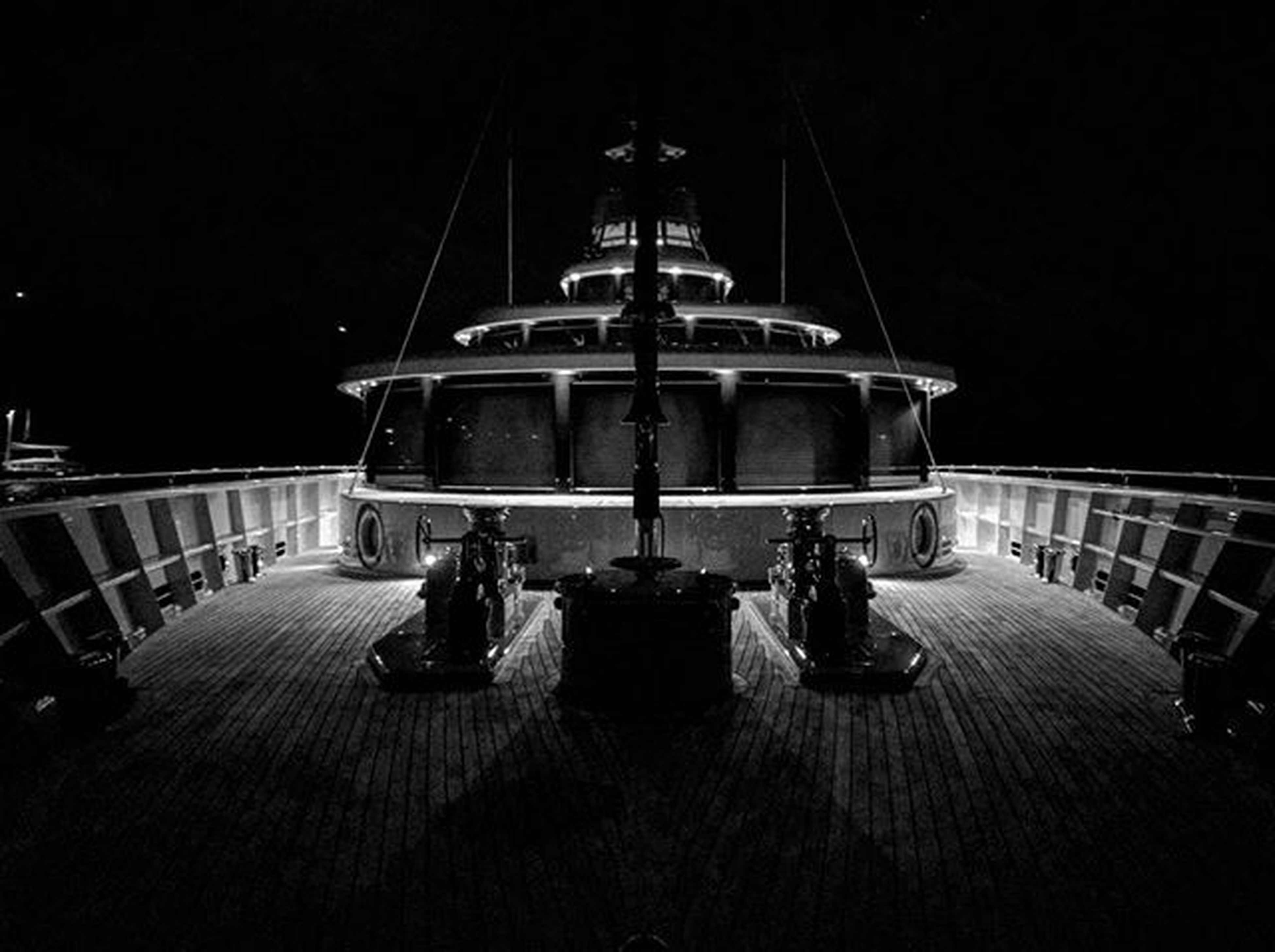 night, transportation, illuminated, men, mode of transport, clear sky, built structure, architecture, lifestyles, railing, leisure activity, person, travel, sitting, incidental people, lighting equipment, outdoors, nautical vessel