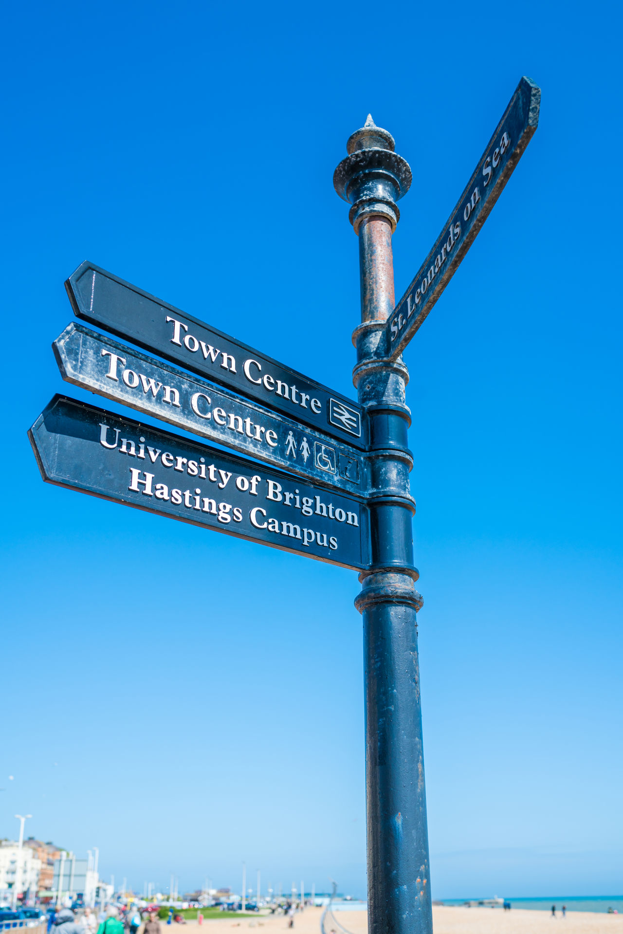Sign post on the beach in Hastings, East Sussex, UK Beach Blue Sky Direction Directly Above Hastings Information Information Sign No People Outdoors Sightseeing Sign Sign Post Signpost Sky Tourism Tourist Travel Travel Destinations