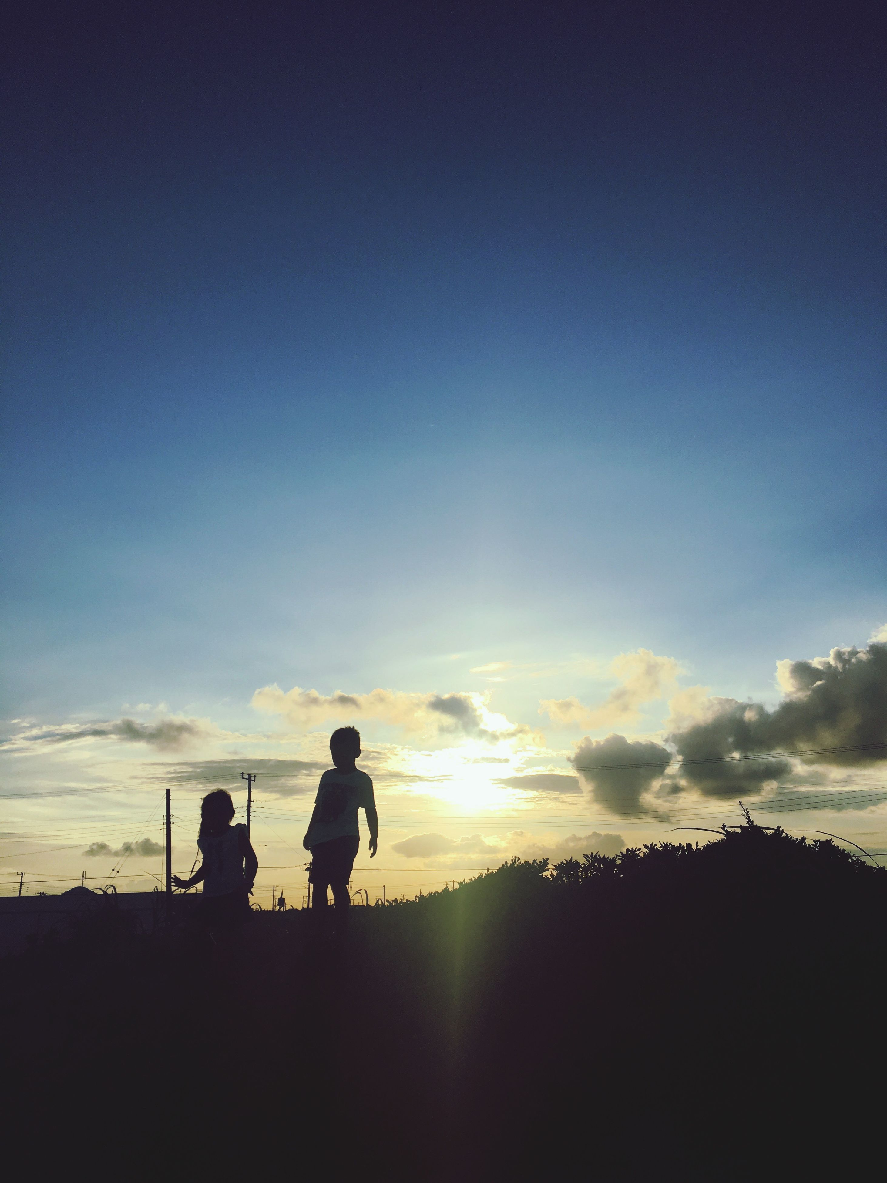 silhouette, sunset, lifestyles, sky, leisure activity, tranquility, tranquil scene, beauty in nature, scenics, nature, idyllic, cloud - sky, outline, landscape, outdoors, cloud, vacations, non-urban scene, orange color