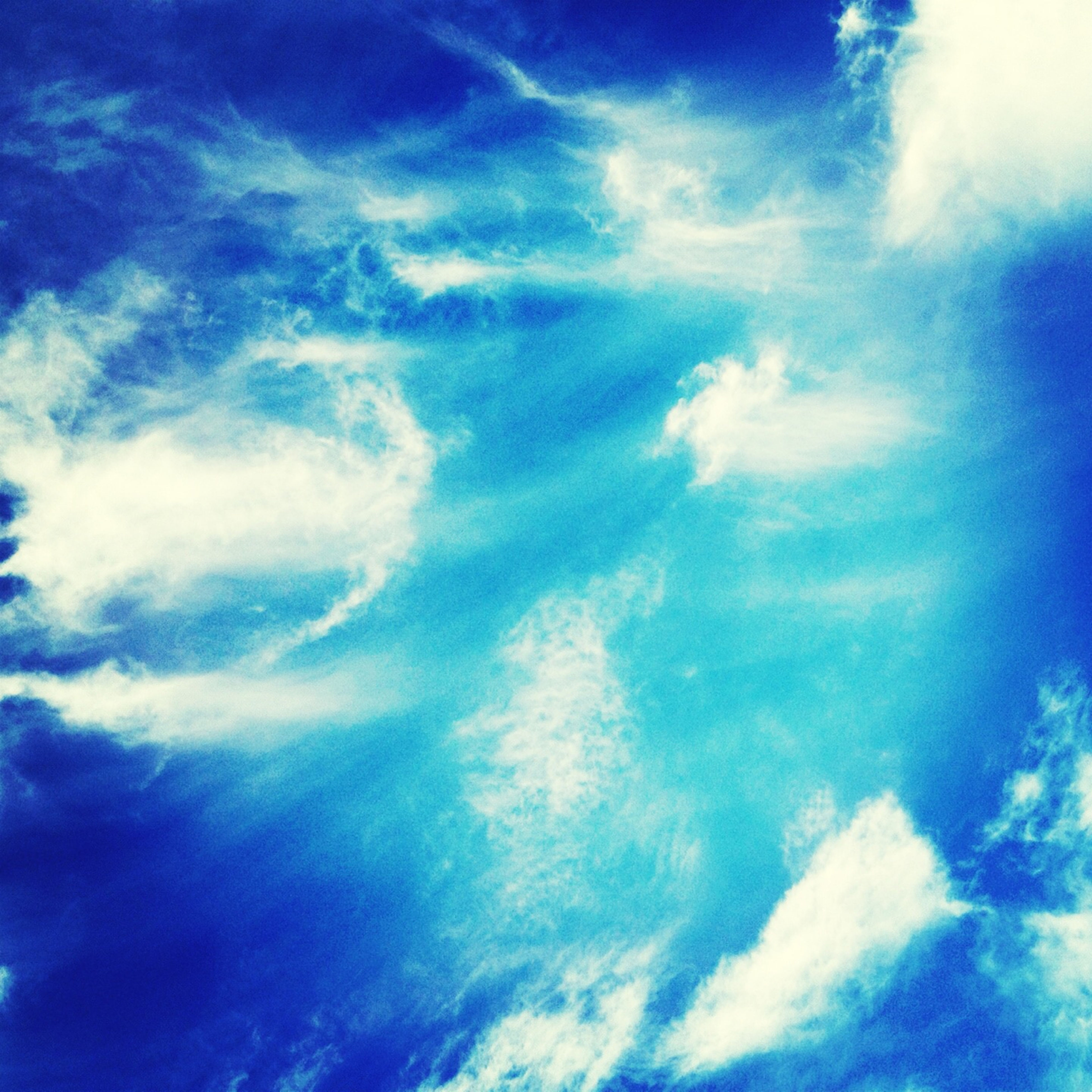 blue, low angle view, sky, cloud - sky, sky only, beauty in nature, tranquility, scenics, backgrounds, nature, tranquil scene, full frame, cloudy, cloudscape, cloud, idyllic, outdoors, day, no people, white color