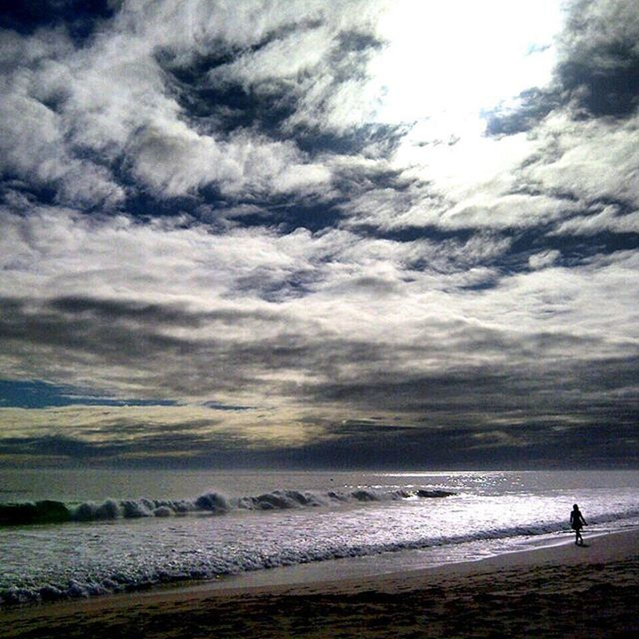 sea, beach, water, cloud - sky, nature, wave, sky, beauty in nature, scenics, outdoors, horizon over water, sand, vacations, tranquility, real people, sunset, day, men, power in nature, one person, people