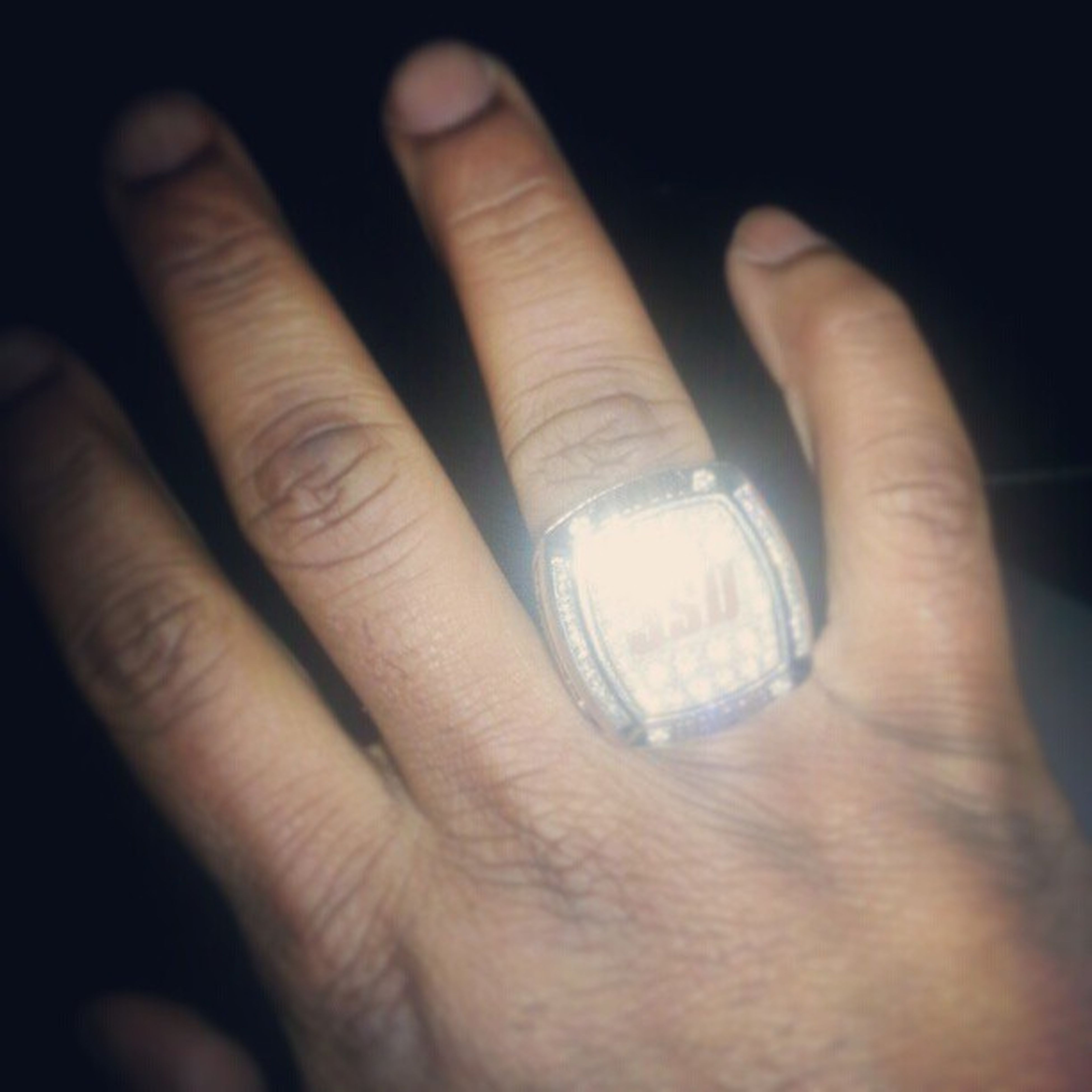 person, part of, human finger, holding, cropped, close-up, indoors, unrecognizable person, personal perspective, focus on foreground, showing, studio shot, ring, glass - material, lifestyles, leisure activity, reflection