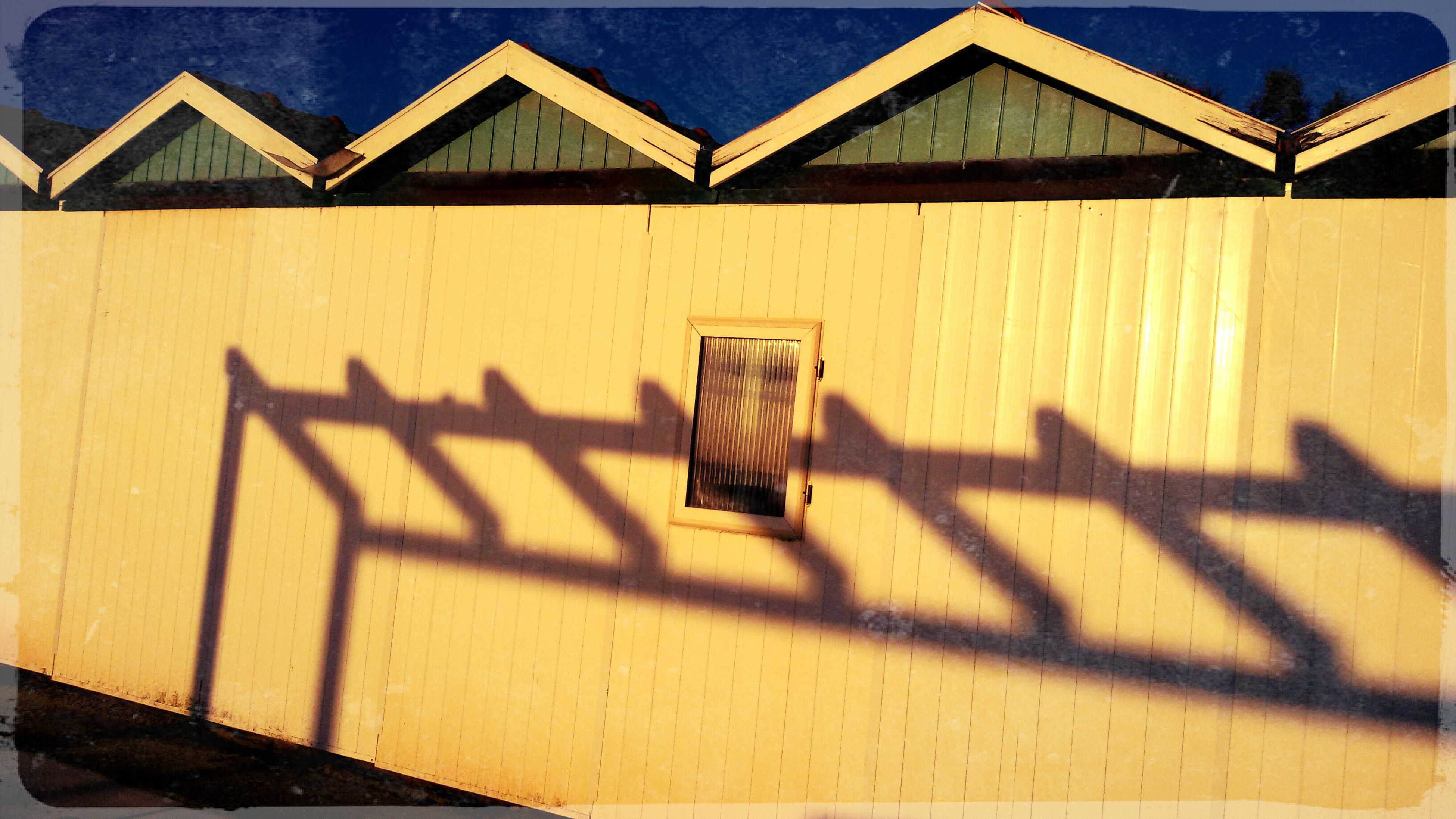 shadow, built structure, architecture, building exterior, sunlight, transfer print, auto post production filter, steps, railing, wood - material, empty, high angle view, bench, day, house, absence, no people, outdoors, staircase, chair