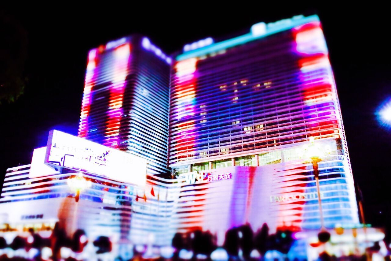 night, large group of people, illuminated, communication, crowd, neon, multi colored, city, outdoors, building exterior, architecture, real people, women, built structure, lifestyles, skyscraper, sky, people