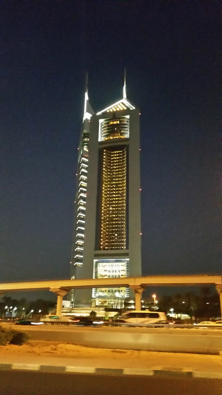 architecture, illuminated, night, tall - high, built structure, travel destinations, building exterior, city, travel, skyscraper, tourism, sky, religion, spirituality, outdoors, no people, modern, clear sky, cityscape