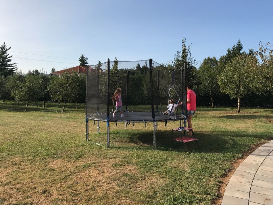 Real People Tree Grass Outdoors Leisure Activity Field Day Clear Sky Sky Lifestyles Nature Men Medium Group Of People Growth Togetherness Boys Women Standing Childhood Friendship Childhood Home Garden