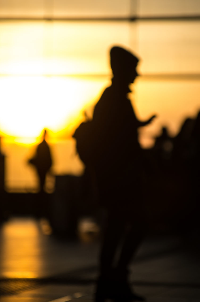 silhouette, real people, full length, sunset, men, two people, women, lifestyles, outdoors, standing, togetherness, sky, day, people