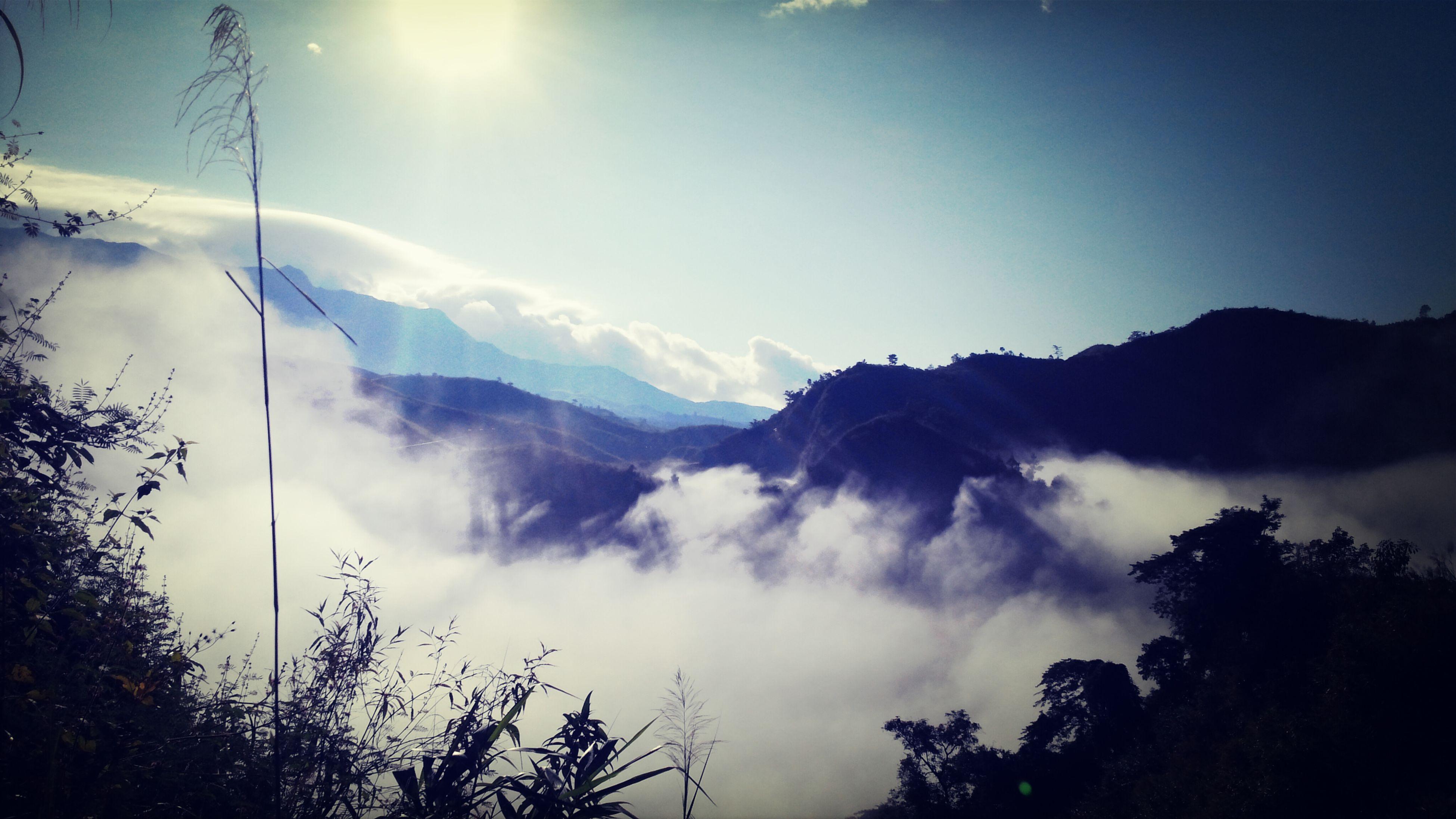 mountain, tranquility, tranquil scene, scenics, beauty in nature, sun, sunbeam, tree, sky, mountain range, nature, sunlight, landscape, lens flare, idyllic, low angle view, cloud - sky, non-urban scene, silhouette, no people