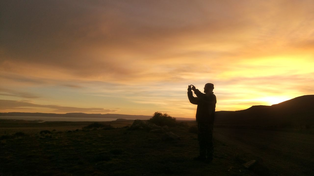 Real People Reflection Photographing Camera - Photographic Equipment One Person Sky Nature Outdoors