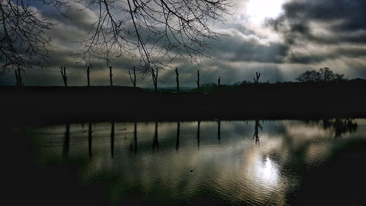 AntiM Beauty In Nature Cloud - Sky Day Extreme Weather Lake Melancholic Landscapes Nature No People Outdoors Reflection Sky Sunset Tranquility Tree Water