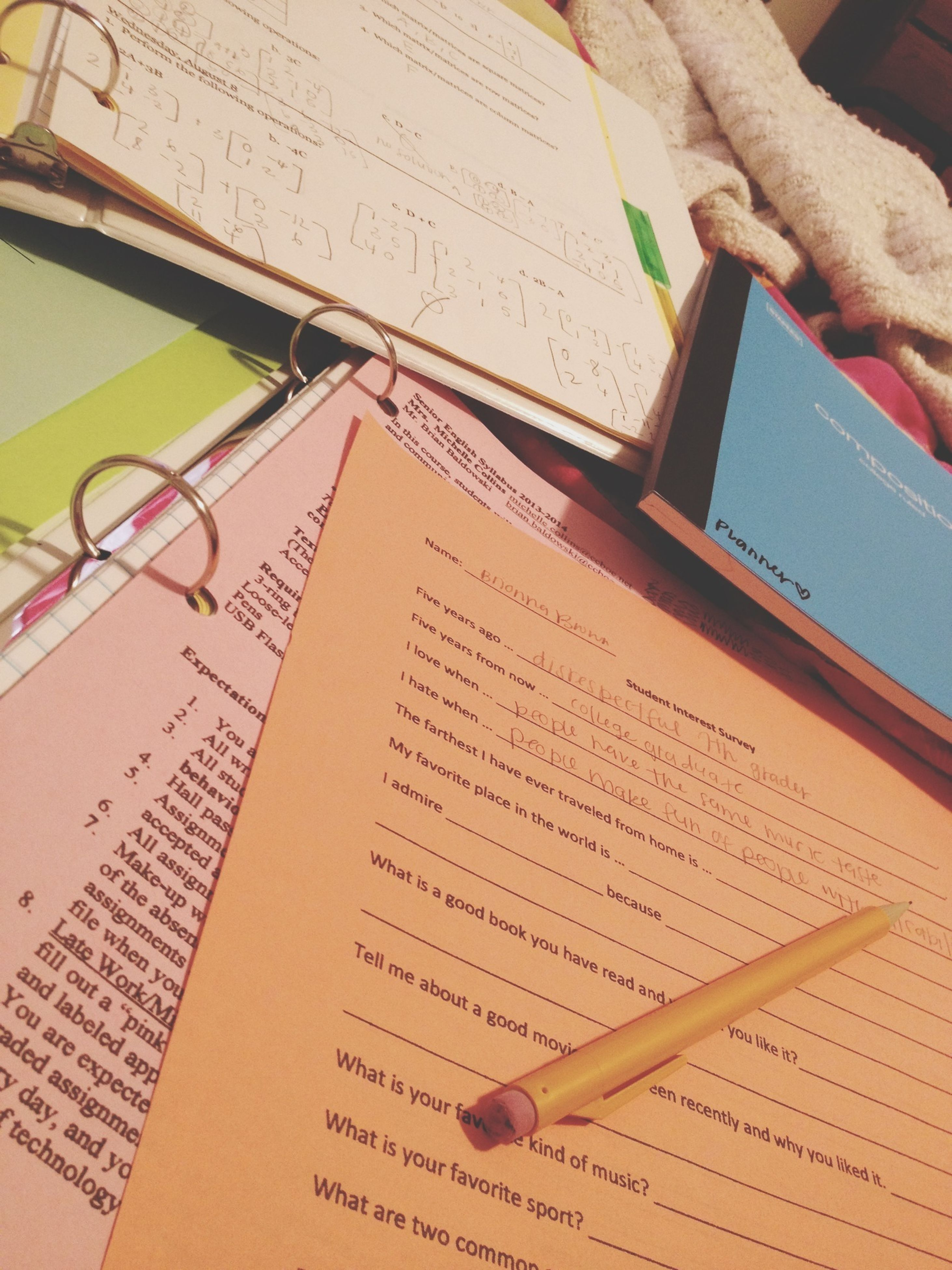 paper, book, indoors, education, high angle view, table, communication, text, pen, document, part of, cropped, close-up, pencil, person, western script, tilt, page, writing, learning