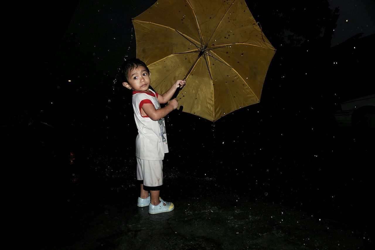 Children Only Child Boy Children Day Outdoors Black Background PeopleOne Girl Only Standing Childhood One Person Full Length Rainy Days Nightphotography Night Raining Drops Of Water Wet Rain Drops Girls Adult Live For The Story