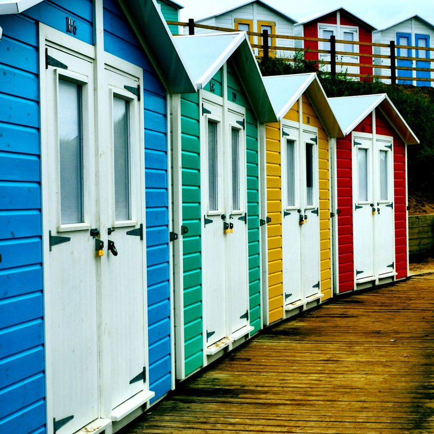 Beach huts in Bude, Cornwall. Beach Huts Beach Hut Beachhuts Beachhut Beach Seaside Coast Bude Cornwall Colours Colour Colors Color Colourful Colorful Green Blue Red Yellow Structure Wooden Structure Holiday Vacation
