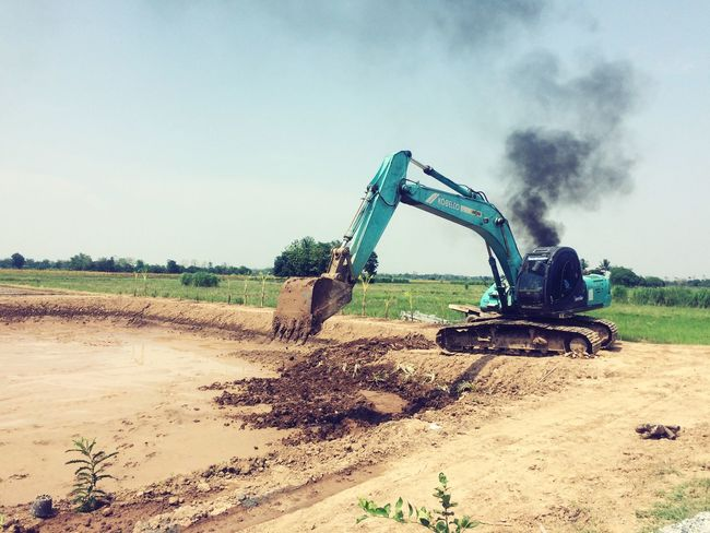 Construction Site Construction Machinery Field Earth Mover Machinery Day Sky Land Vehicle Outdoors Landscape No People Industry Nature Combine Harvester