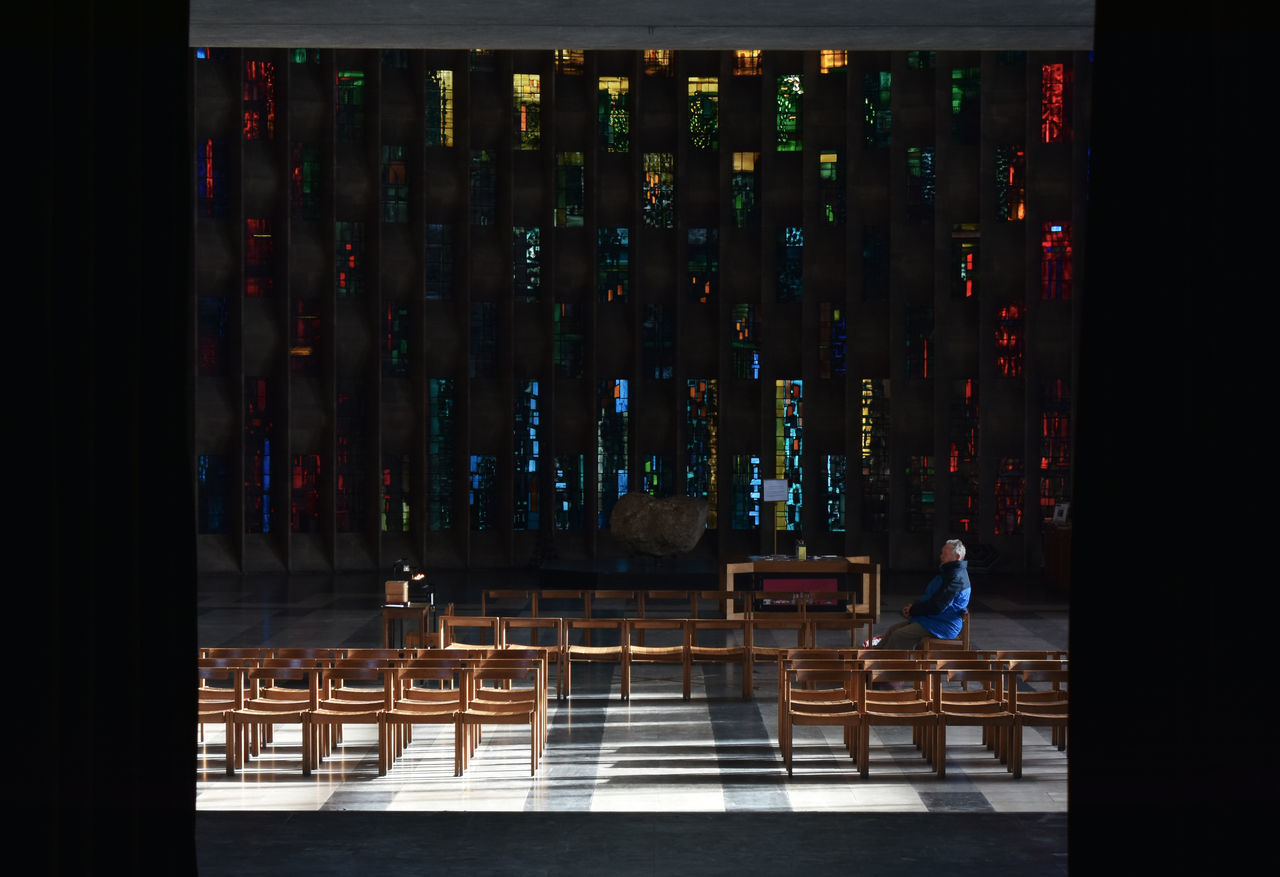 Adult Alone Chairs City Contemplation Coventry Cathedral - UK Framed Full Length Indoors  One Man Only One Person People Place Of Worship Prayer Seating Sitting Spirituality Stained Glass Window