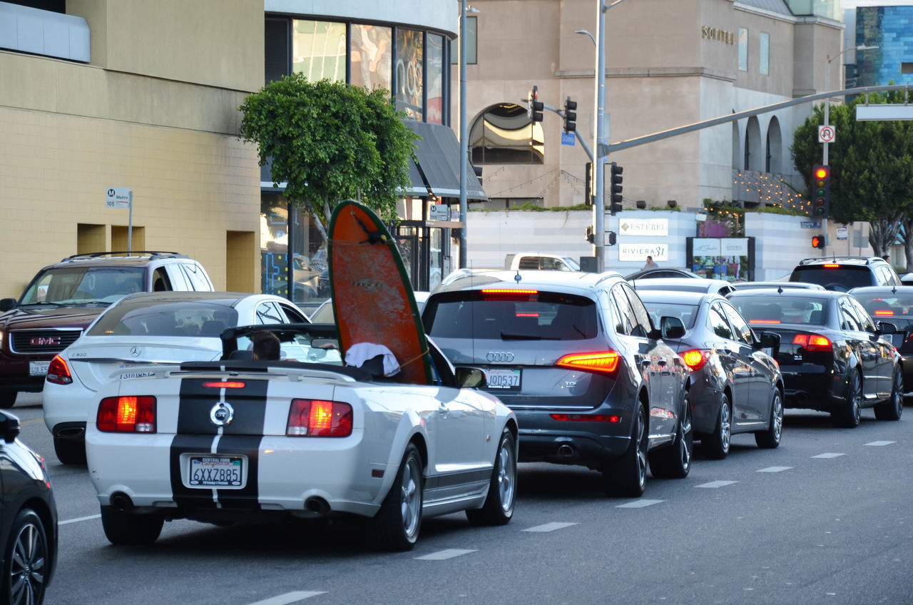 Driving Casual Be Cool  Be Yourself City Life City Street Confidence  Convertible Do Your Thing Go Surfing Hollywood Los Angeles, California Mode Of Transport Mustang GT Never Worry No Stress Red Light Surfboard And Cars Surfers Life Surferslife Surfing Life Towards The Sun Traffic Jam Traffic Lights Transporting Genius Vacation Activities Vacation Schedule EyeEmNewHere