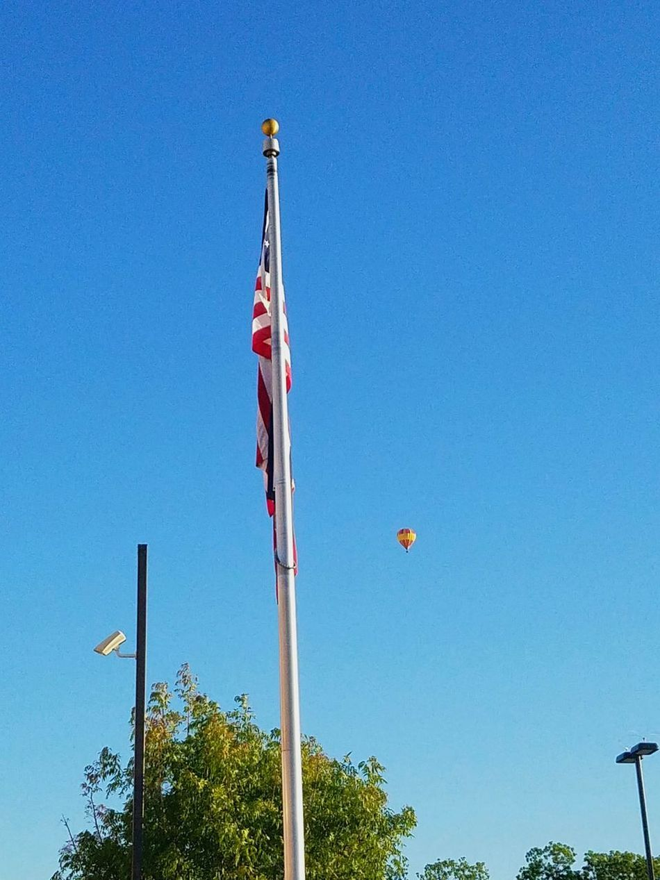 Flag Sky Blue Day Patriotism Flying Clear Sky Low Angle View Outdoors Airshow No People Nature Teamwork Air Baloon