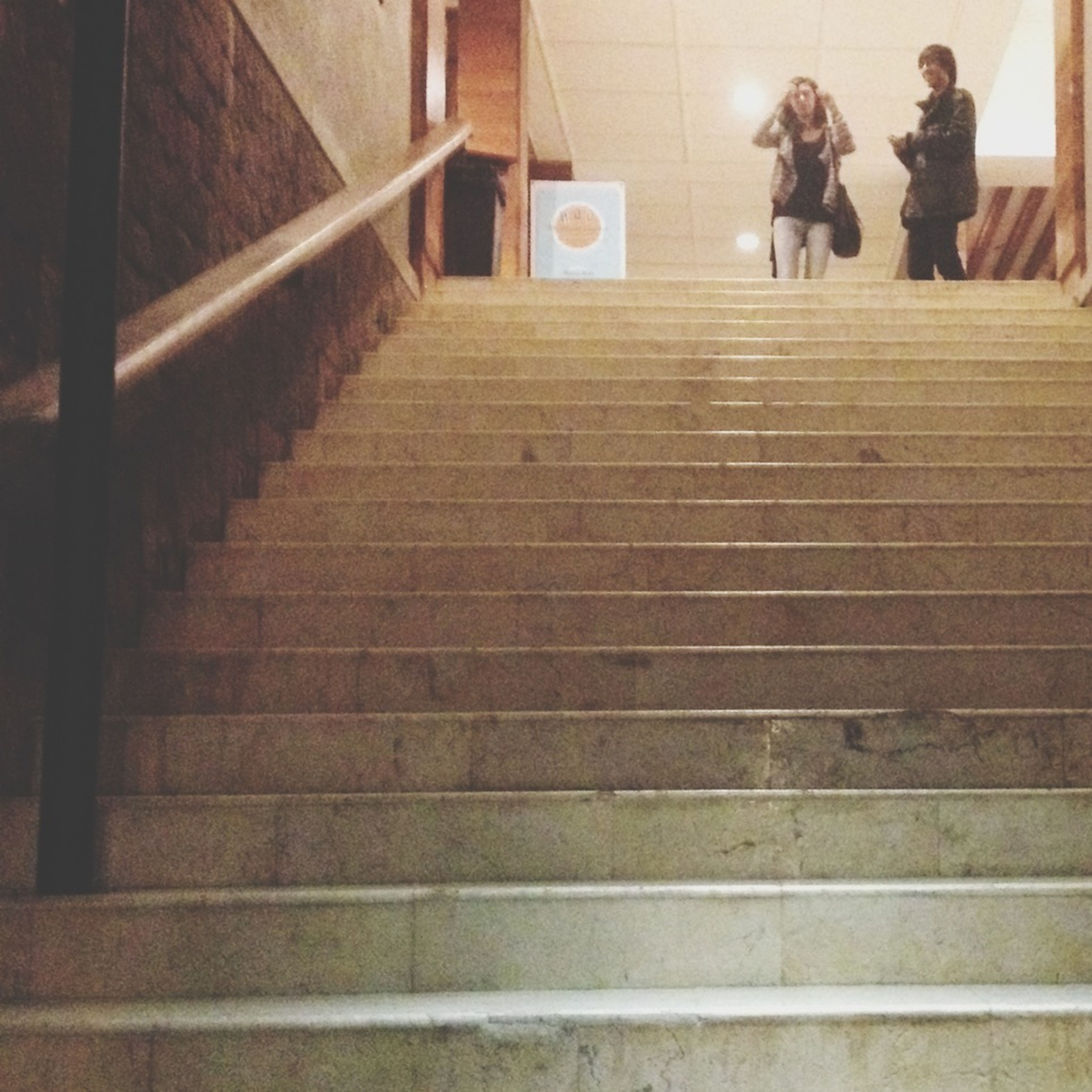 steps, steps and staircases, staircase, indoors, railing, architecture, built structure, stairs, low angle view, the way forward, men, wall - building feature, moving up, escalator, moving down, walking, full length, high angle view, building