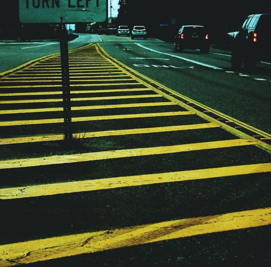 Yellow Road Marking Striped Transportation Outdoors No People Day City Travel Lines Street Turn Left Passing Cars Traffic Vehicles On Road Driving In Car On The Road Road Roads Highways