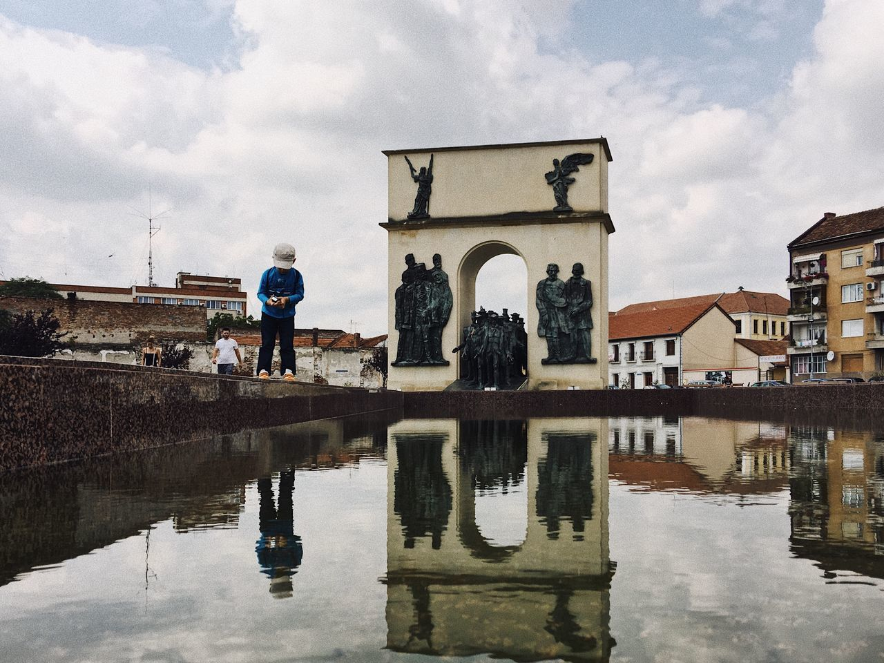 Childhood reflection... Water Architecture Sky Reflection Lifestyles Puddle Sculpture Nature Outdoors People Child Childhood Cloud - Sky Made In Romania VSCO Details Of My Life My Favorite Photo Real People Building Exterior Cityscape City Park Tourist Attraction  City Life Neighborhood Map
