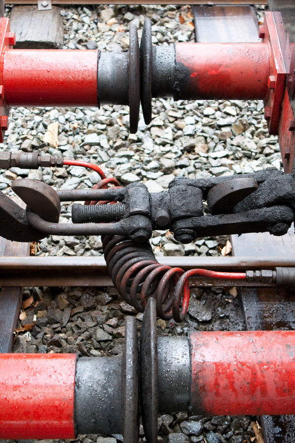 Buffers Cable Cconnect Chain Close-up Coil Couplings Detail Focus On Foreground Hanging Metal Metallic No People Old Old-fashioned Railway Red Rusty Security Strength Tracks Train