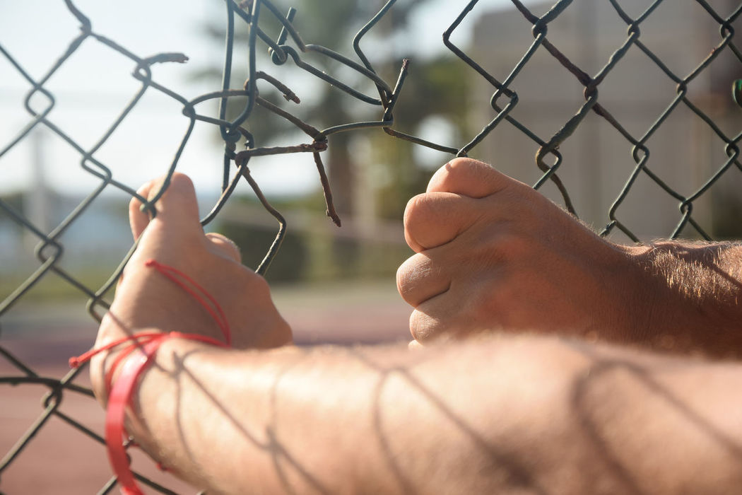 One Person Human Body Part Only Men Close-up Outdoors Men One Man Only Human Hand Block Freedom Escape PeopleHostage Prisoner Prison Wire Jail Behind Chainlink Fence Adult Torn Day Adults Only Chain Catch