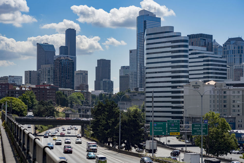Daytime downtown Seattle in summer Architecture Building Exterior Built Structure Business City City Life Cityscape Cloud - Sky Commuters Congestion Day Highway Modern No People Outdoors Seattle Washington Sky Skyline Skyscraper Traffic Transportation Travel Tree Urban Skyline Vacation