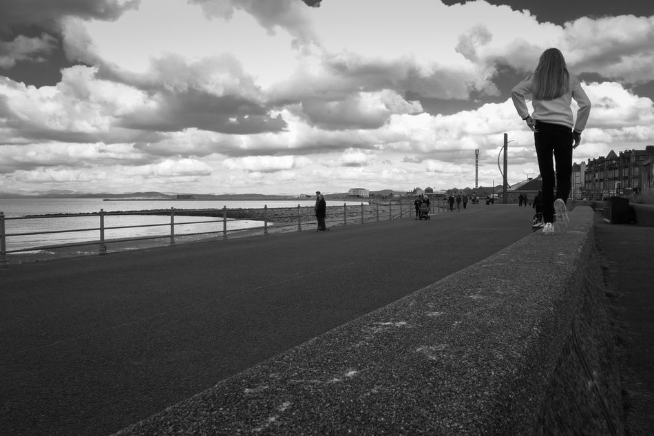 Wall Walker Beach City Cloud - Sky Day Leisure Activity Lifestyles One Person Outdoors People Real People Sea Sky Travel Destinations