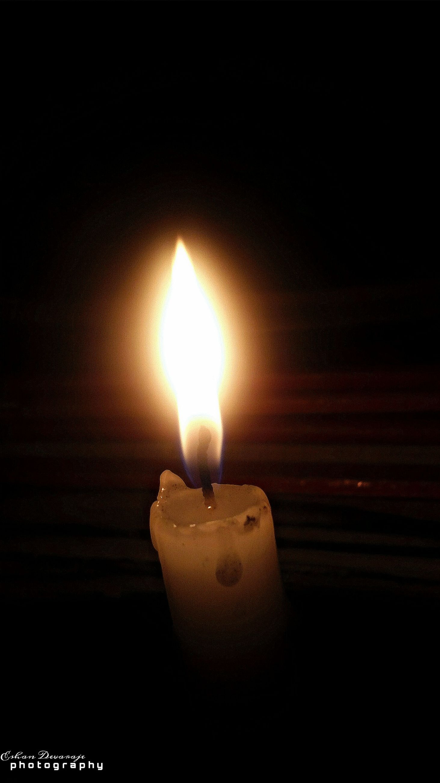 flame, illuminated, burning, glowing, heat - temperature, night, fire - natural phenomenon, dark, candle, indoors, lit, light - natural phenomenon, close-up, darkroom, fire, lighting equipment, copy space, no people, black background, candlelight