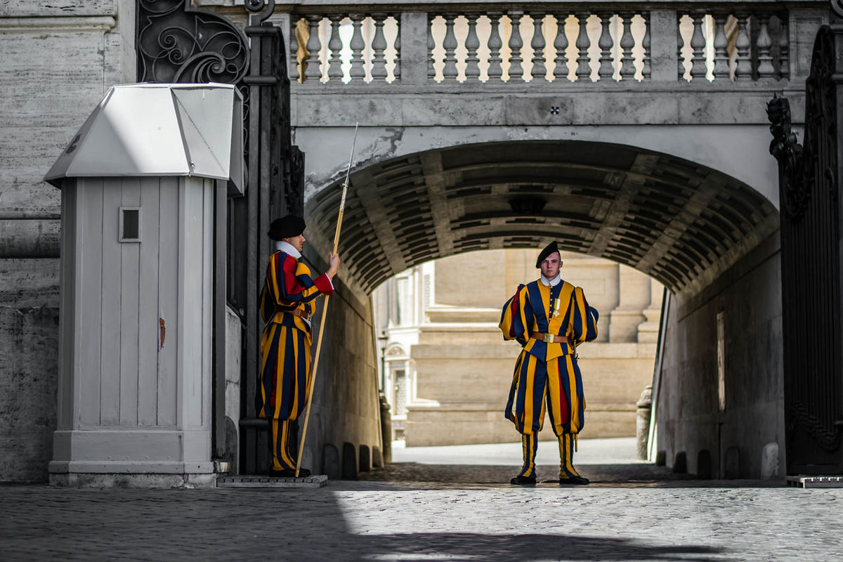 Arch Arched Architecture Building Exterior Built Structure Creativity Day Entrance Façade Guarding History Human Representation Monument Outdoors Patrol  Place Of Worship Statue Swiss Guard Vatican