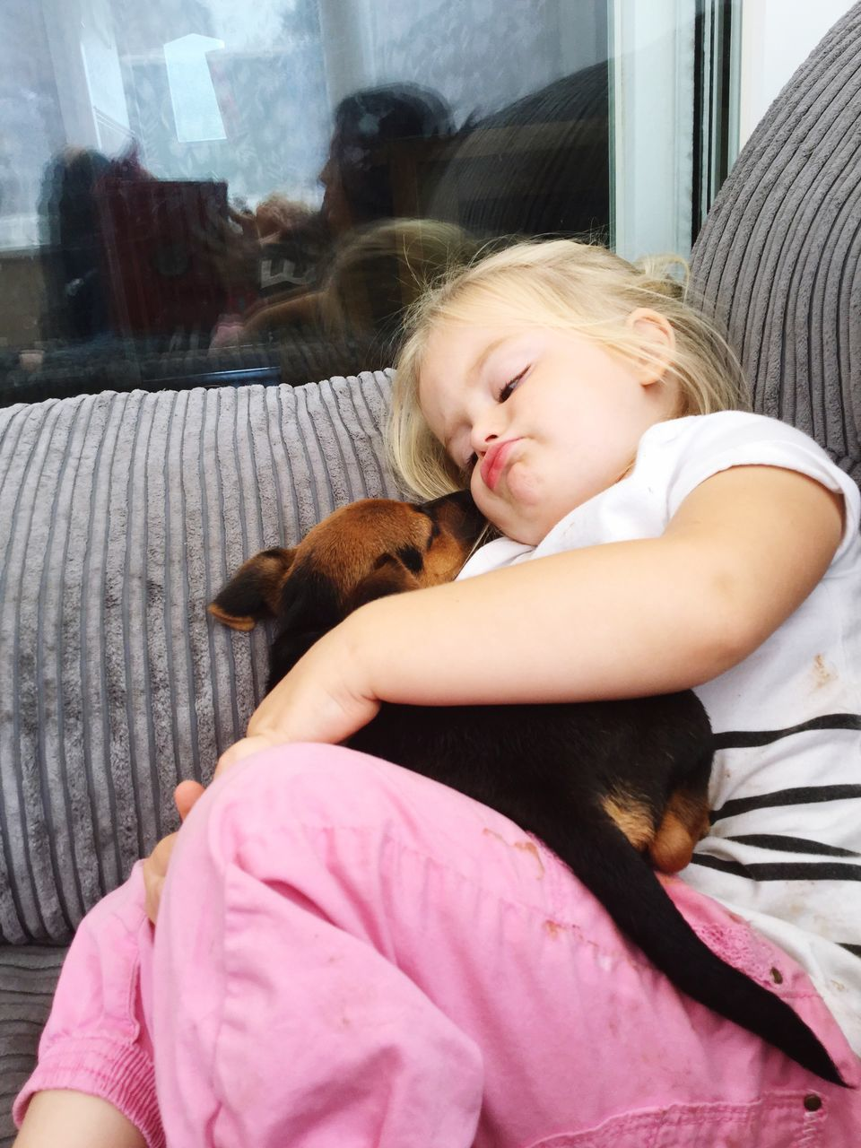 real people, one animal, pets, domestic animals, animal themes, mammal, sleeping, one person, childhood, home interior, bed, dog, indoors, cute, girls, bonding, relaxation, sitting, lifestyles, day