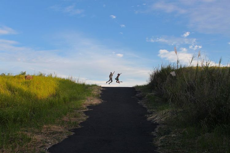 Holiday Manado - North Sulawesi, Indonesia. Sulawesi Beauty In Nature Day Field Friendship Full Length Grass Landscape Leisure Activity Lifestyles Men Nature Outdoors People Plant Real People Scenics Sky Tranquil Scene Walking Women The Week On EyeEm EyeEmNewHere