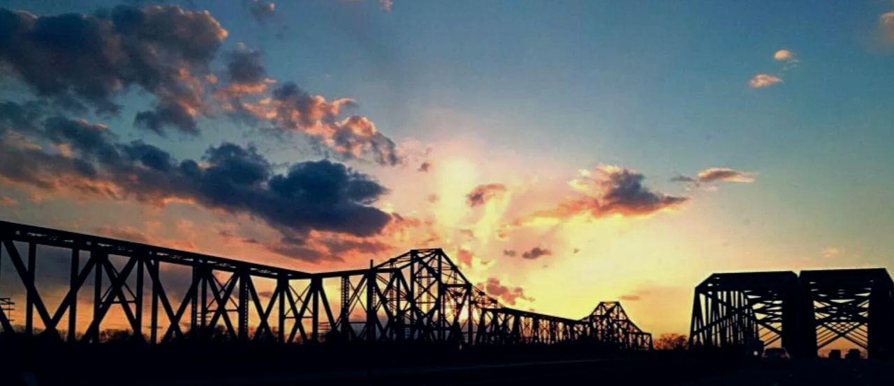 Discovery Enjoying The Sun Sunset Bridges Sunset Silhouettes