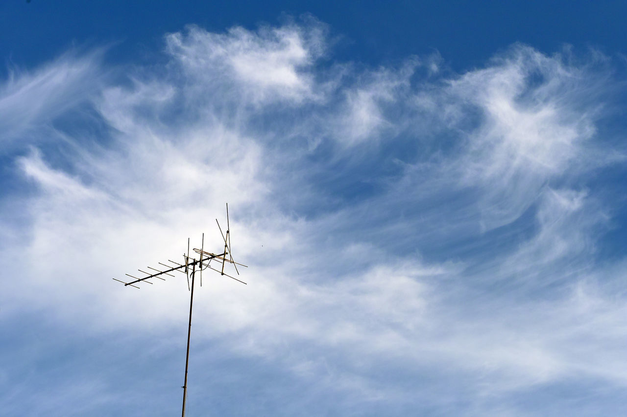 cloud - sky, low angle view, sky, technology, no people, blue, antenna - aerial, day, outdoors, television aerial, nature, beauty in nature