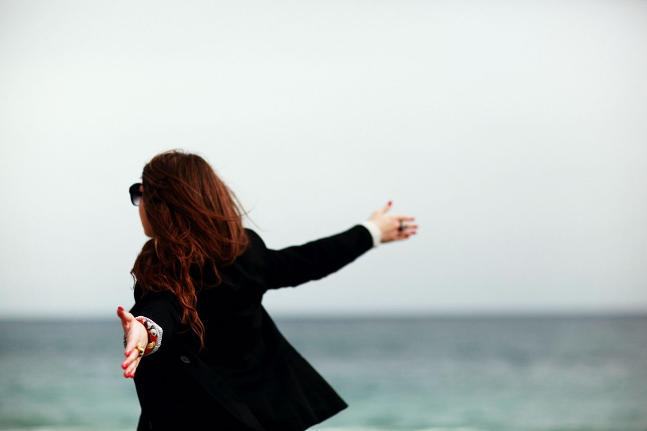Beautiful stock photos of freedom, Arms Outstretched, Beach, Carefree, Clear Sky
