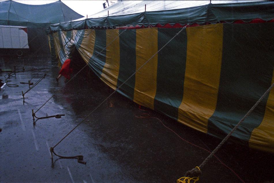 It's showtime Canvas Carnival Downpour Fair Fairground Rainy Day Sideshow Sideshow Acts