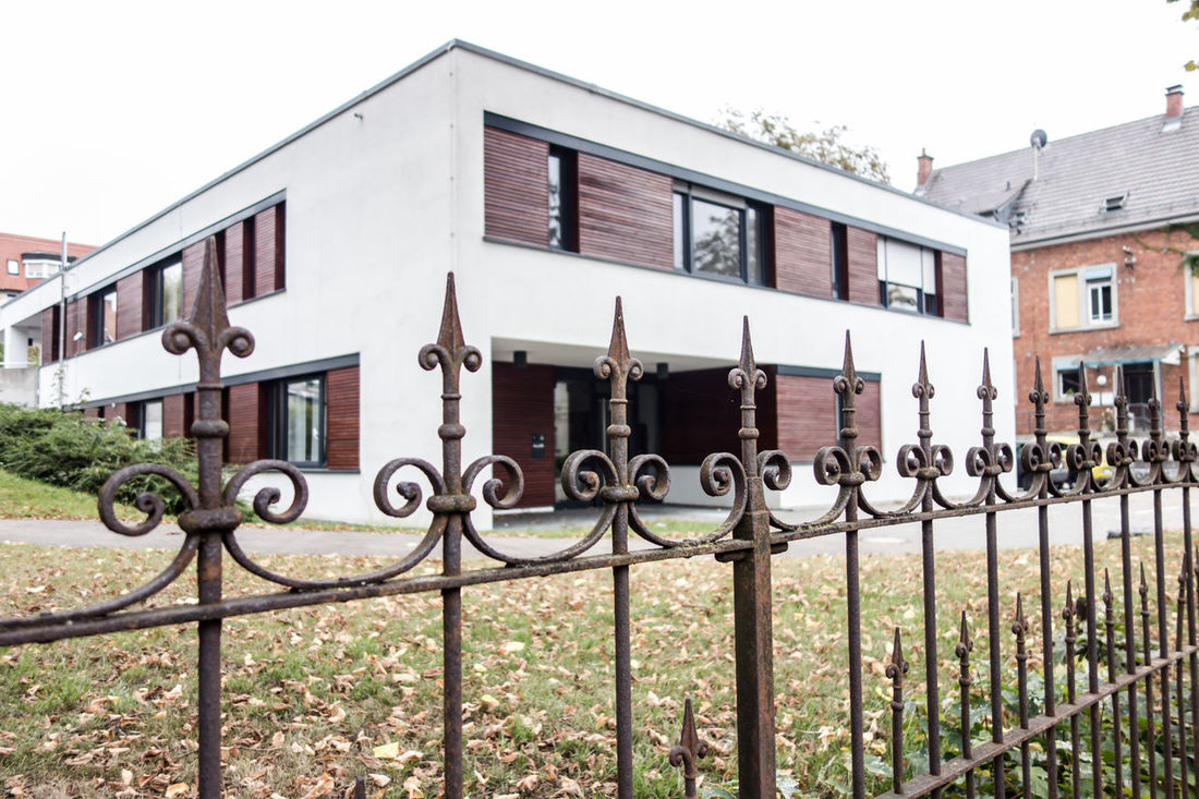 Architecture Building Exterior Built Structure Day Entrance Façade Fence Fences Gate In Front Of Iron - Metal Metal Mode Of Transport Old And New Outdoors Protection Safety Security Sky Steal Steampunk Transportation Window Wrought Iron
